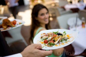Tips for Restaurant Dining and the HCG Diet. Photo of Waiter serving an appetizer